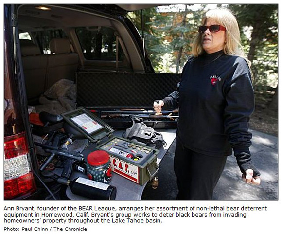 Ann Bryant with non-lethal bear deterrent equipment